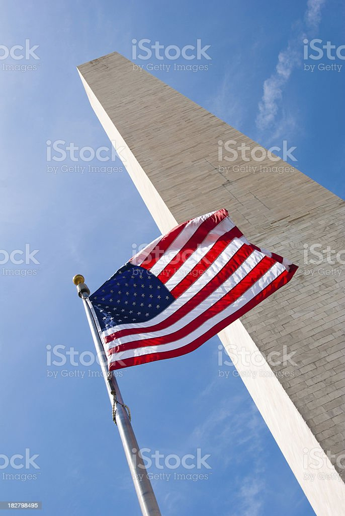 Flapping flag in front of Washington Monument royalty-free stock photo