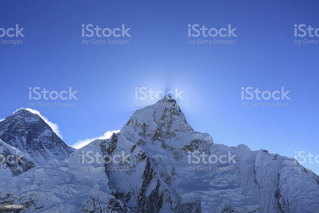 flare over nuptse  beside of everest from kallapather summit royalty-free stock photo