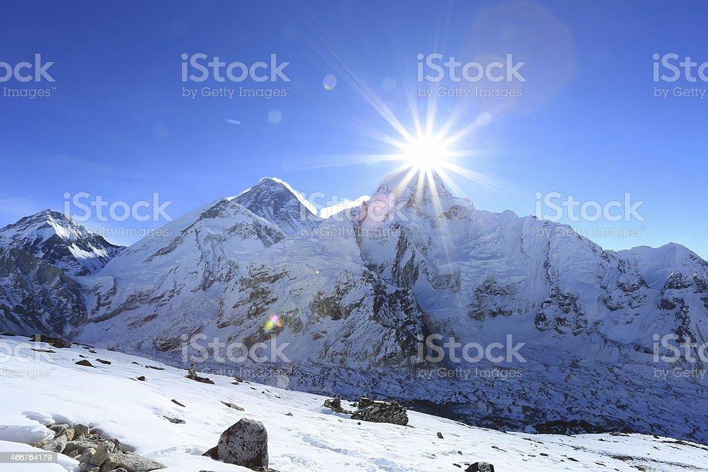flare over nuptse summit beside of everest royalty-free stock photo