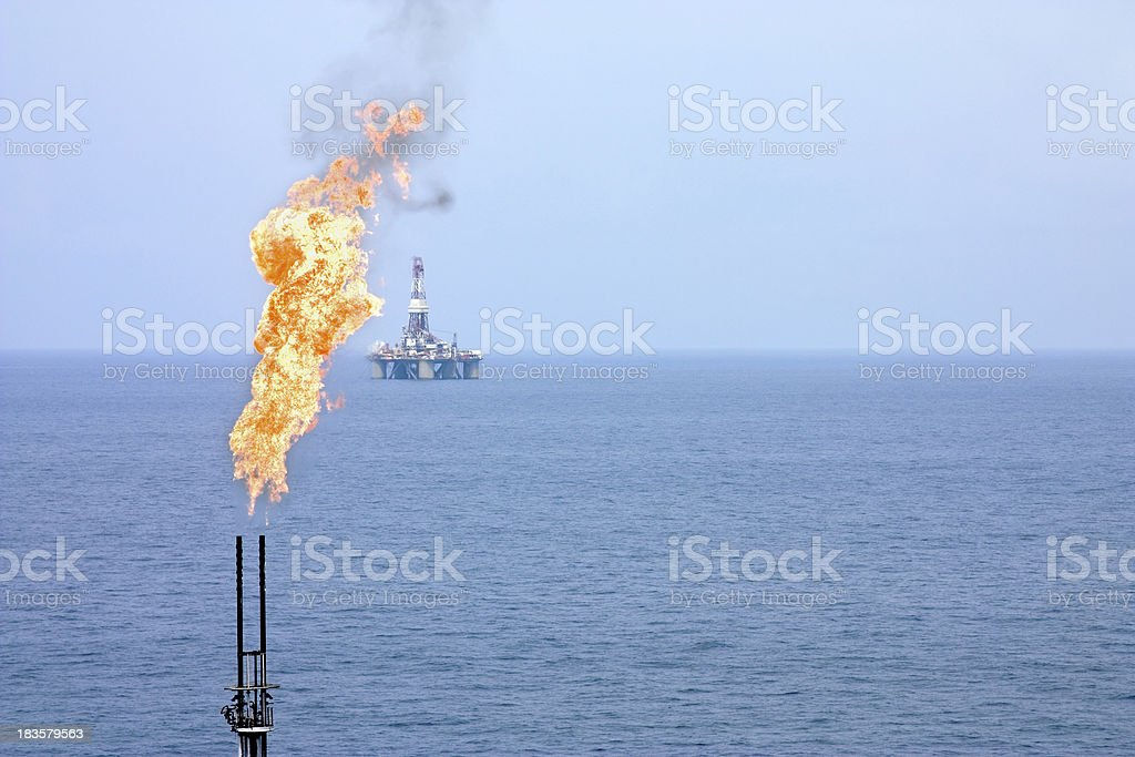 Flare stack and oil rig royalty-free stock photo