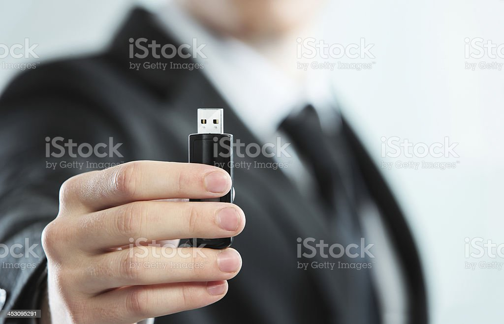 Flash drive in hand stock photo