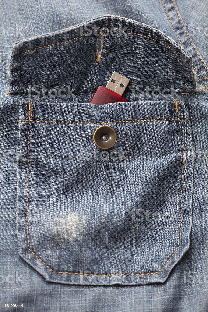 USB flash drive in the denim shirt pocket royalty-free stock photo