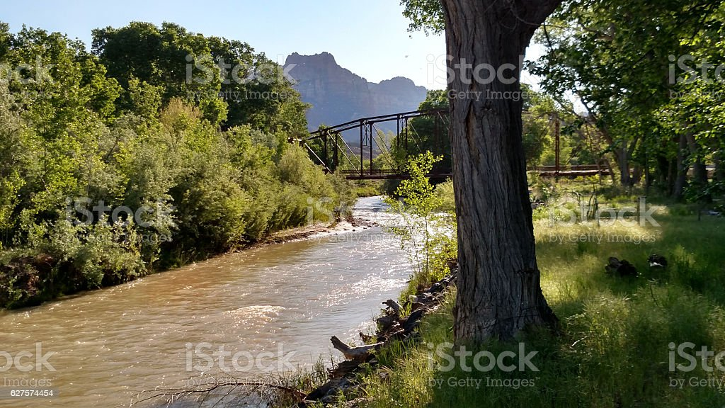 Flash flood Virgin River summertime Historic Rockville Bridge Utah stock photo