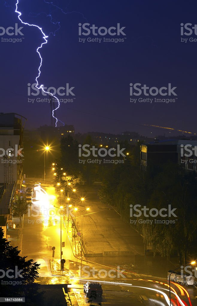 Flash in  storm over  small street stock photo