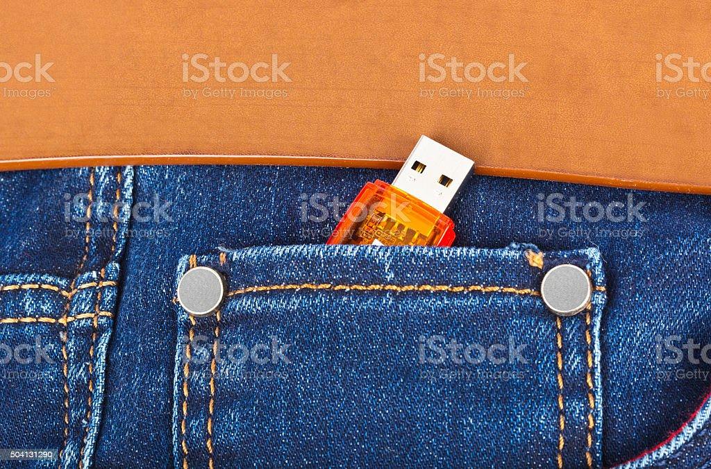 USB flash memory in jeans pocket stock photo
