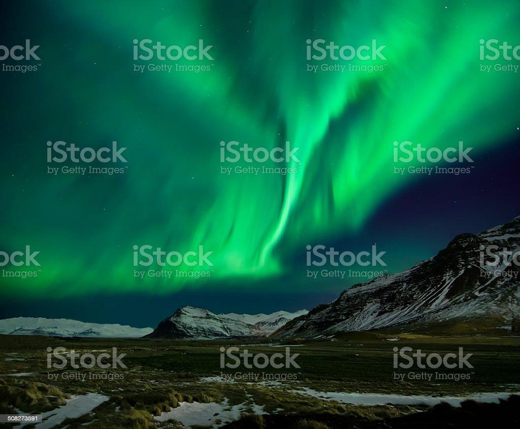 Flash of Aurora polaris above mountains royalty-free stock photo