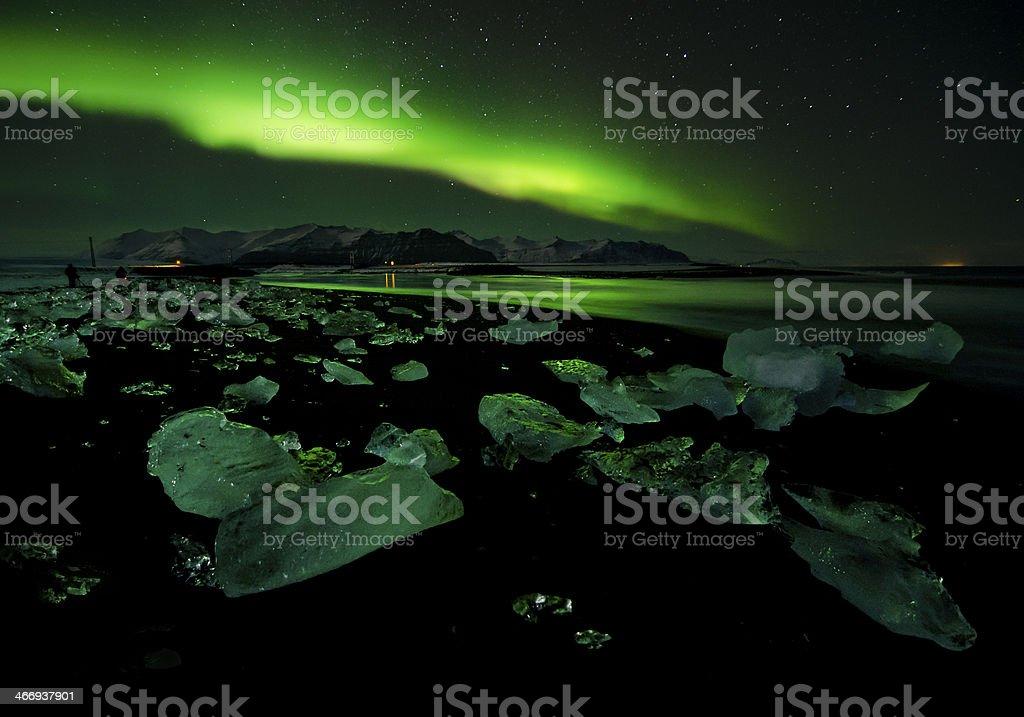 Flash of Aurora polaris above water royalty-free stock photo