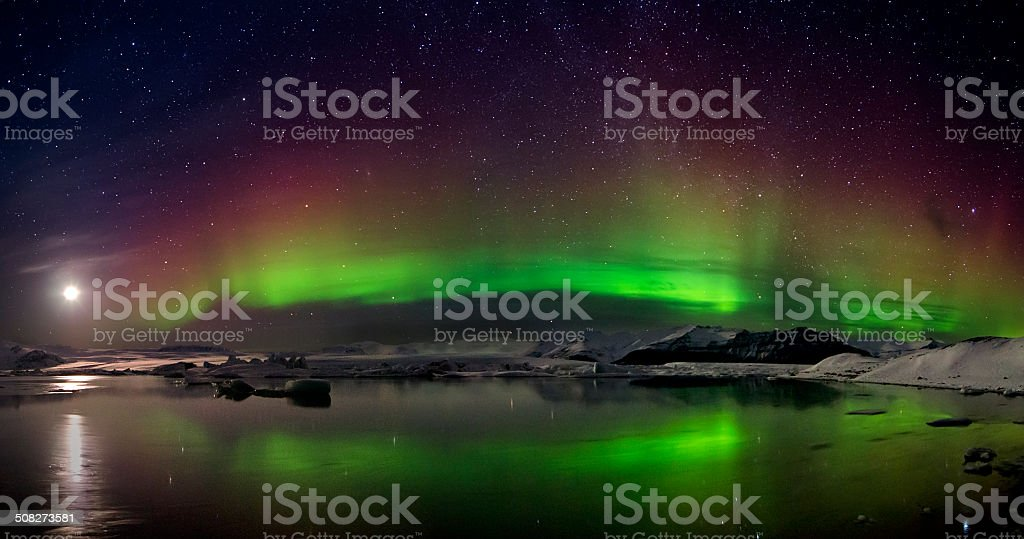 Flash of Aurora polaris above water royalty-free stock photo