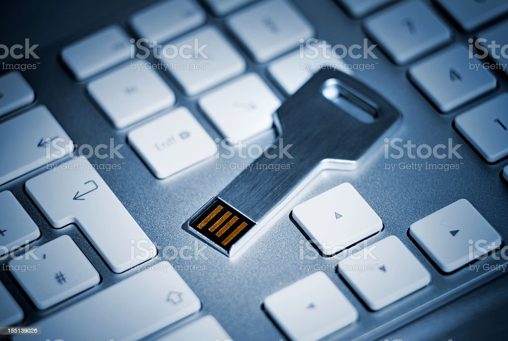 USB flash storage Key on Keyboard stock photo