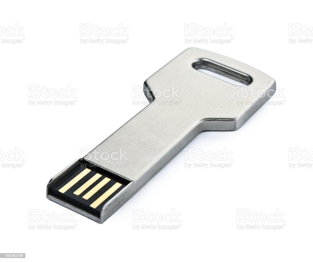 USB flash storage metal key on white macro stock photo