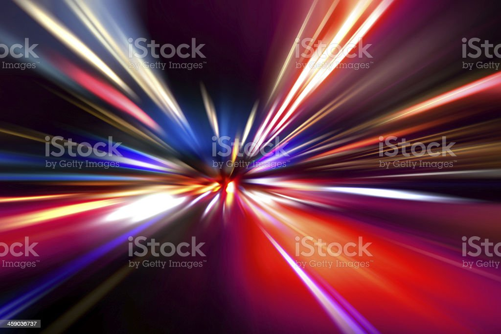 Flashes of bright lights heading towards a central point stock photo