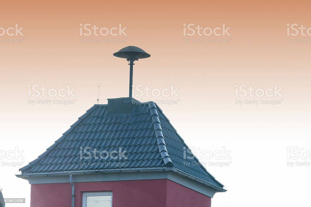 Flashes over a small tower with Air Raid Siren stock photo
