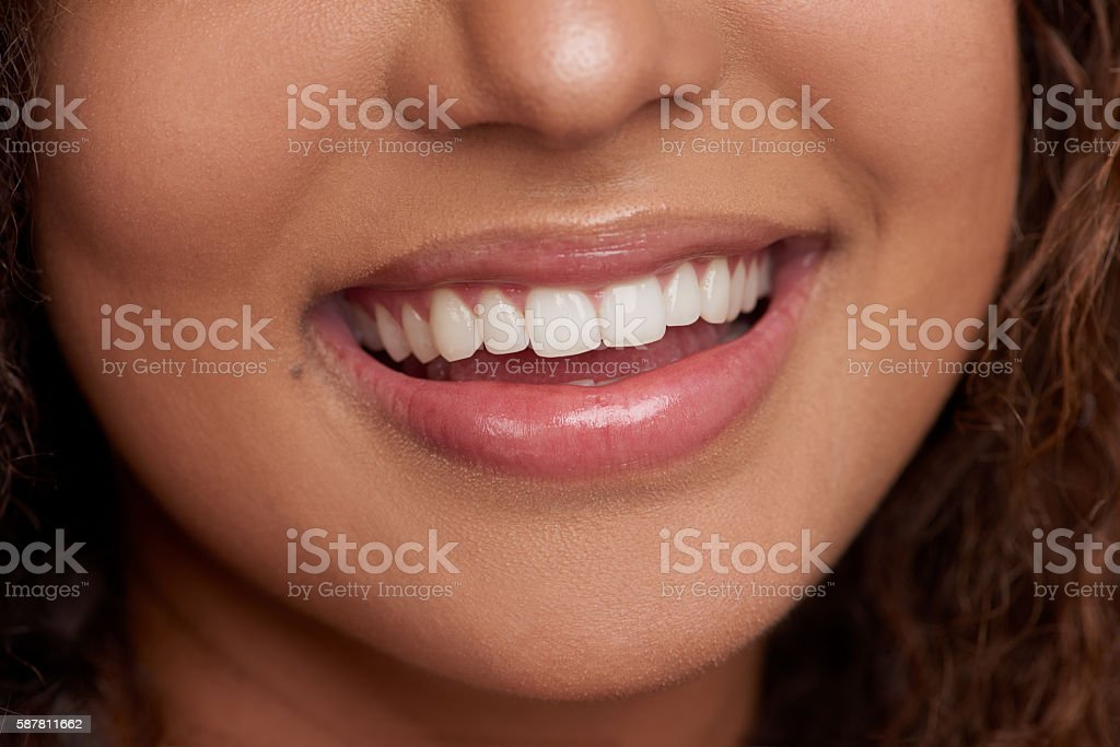 Flashing her brightest smile stock photo