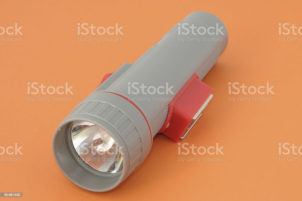 flashlight on orange stock photo