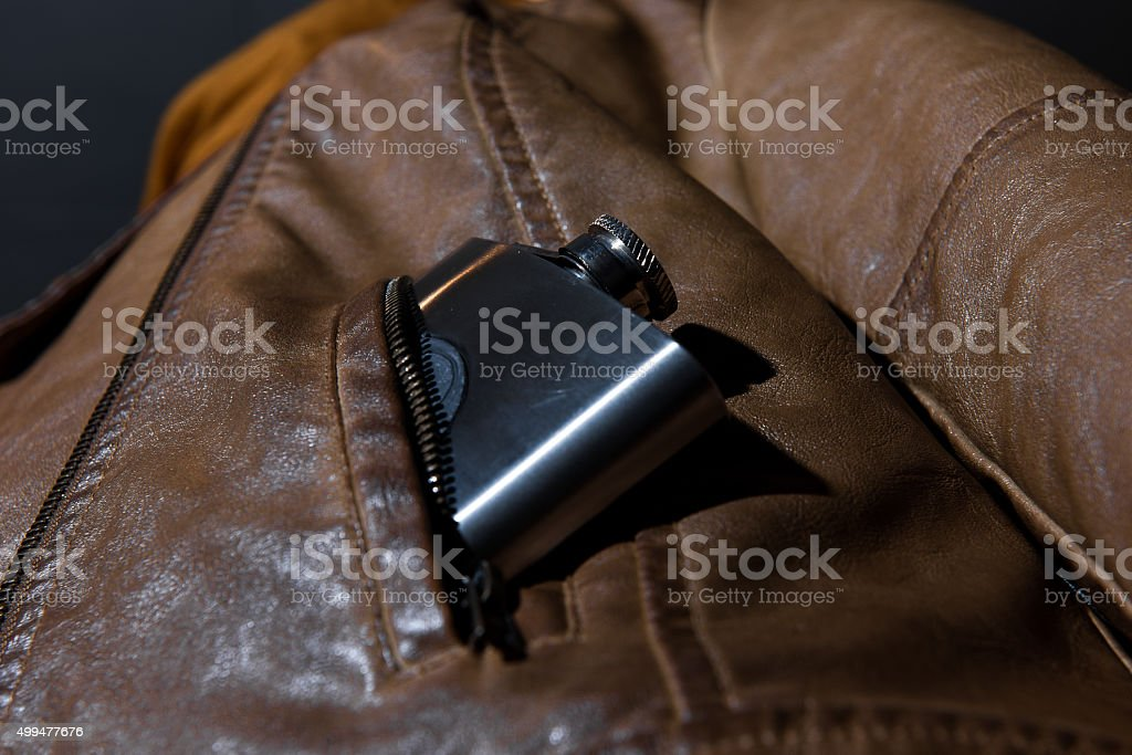 Flask in pocket stock photo