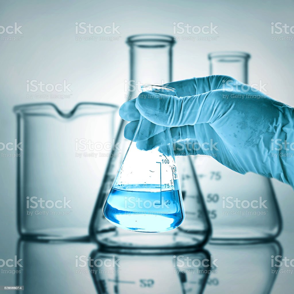 Flask in scientist hand stock photo