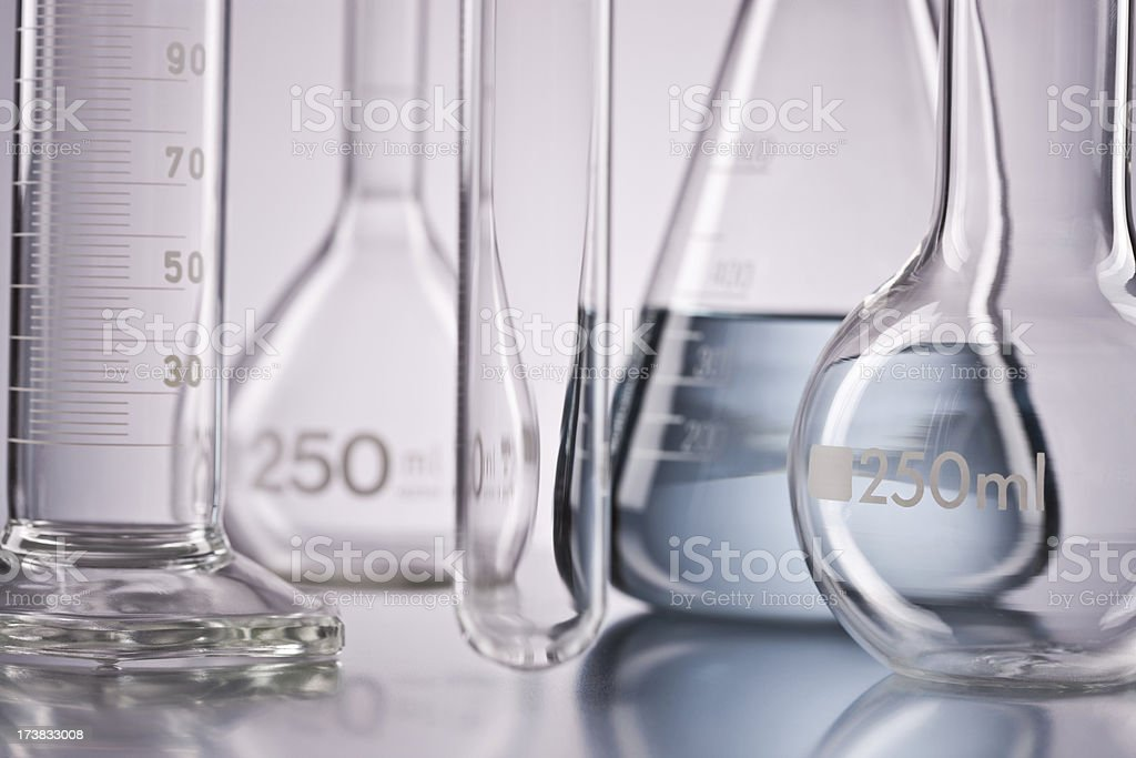 Flask with chemicals and test tubes over isolated background stock photo