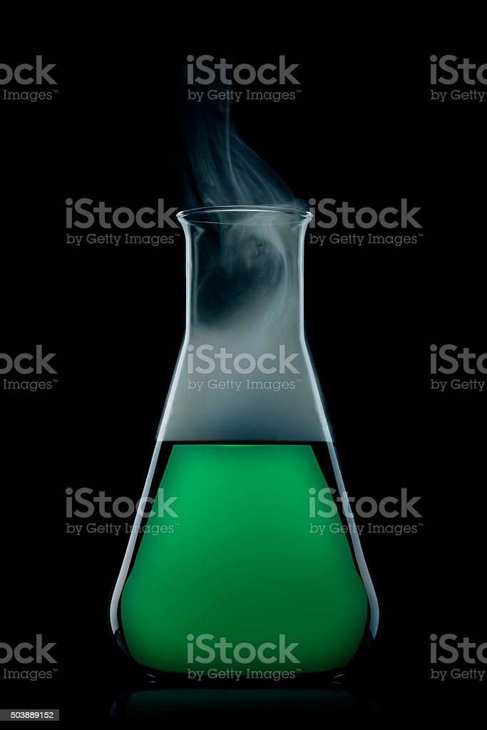 flask with green liquid stock photo
