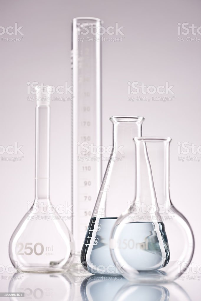 Flasks and test tube placed over isolated background royalty-free stock photo