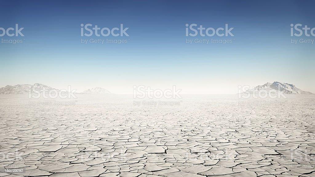 Flat and barren desert away from society stock photo