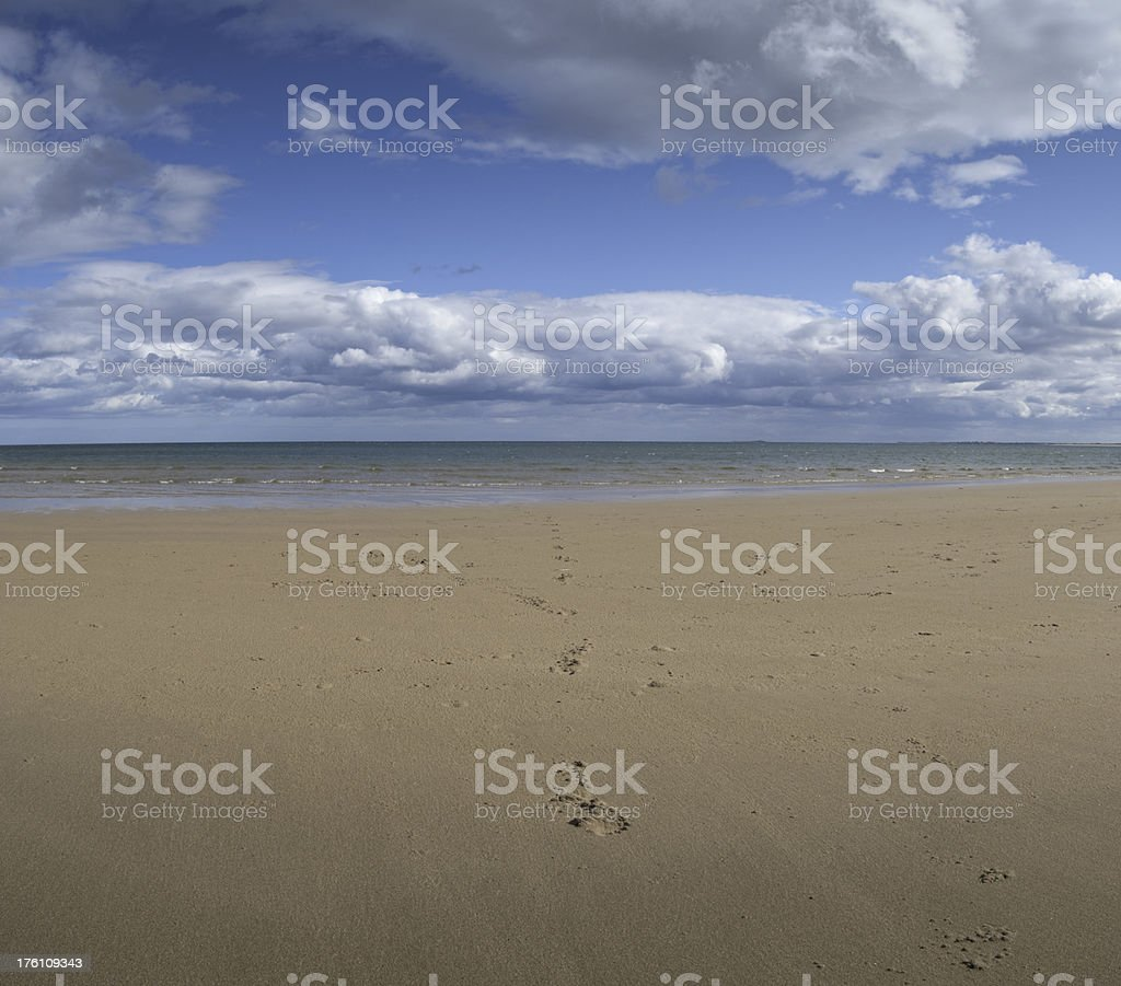 Flat beach, shoreline and cloudscape, UK royalty-free stock photo