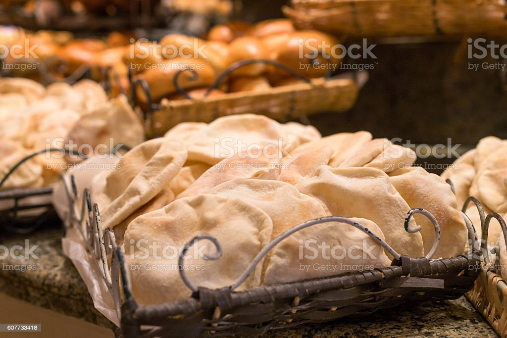 flat bread composition on the basket in restaurant table stock photo