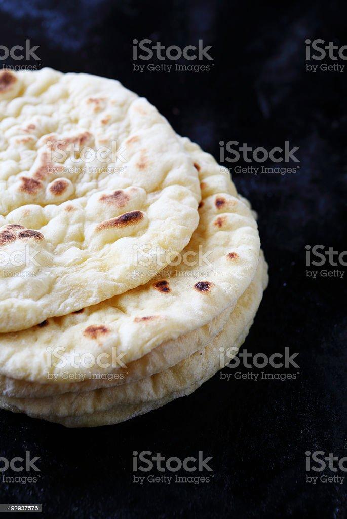 flat bread on baking tray stock photo