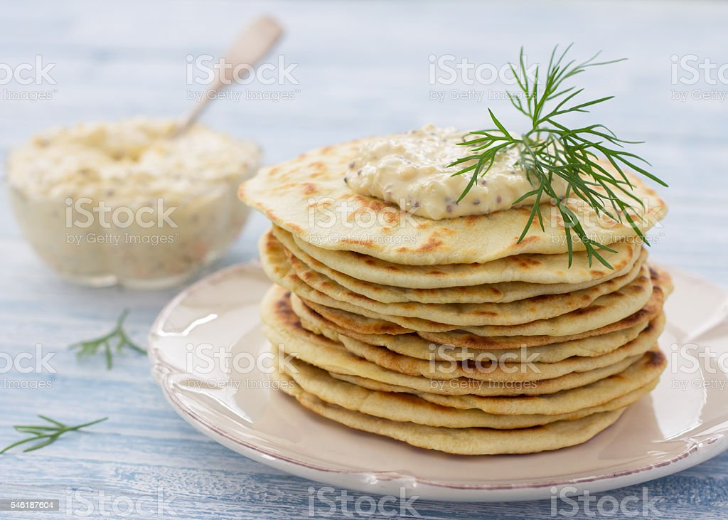 Flat bread with egg dip and dill stock photo