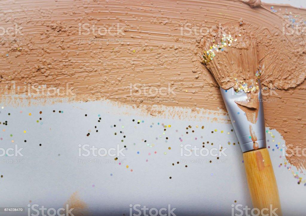 Flat brush in foundation stock photo