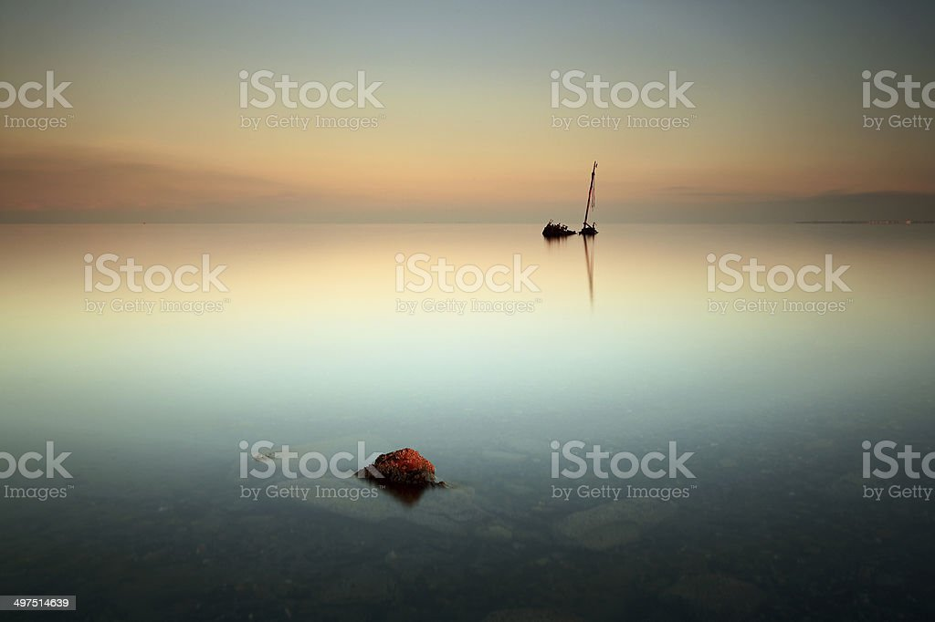 Flat calm shipwreck stock photo