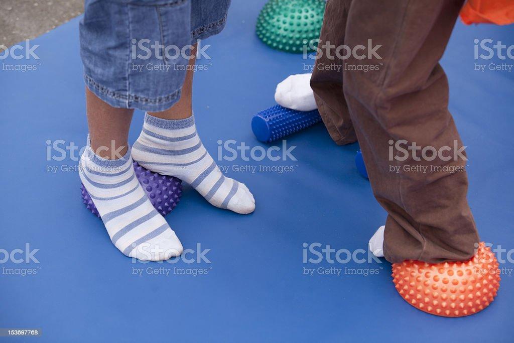 Flat feet treatment for children stock photo
