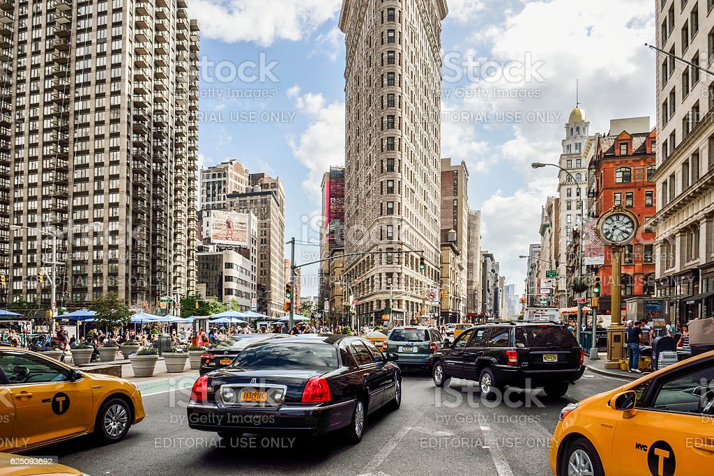 Flat Iron building with NYC Fifth Avenue and taxi cabs stock photo