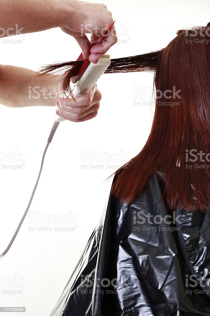 Flat Ironing Hair royalty-free stock photo