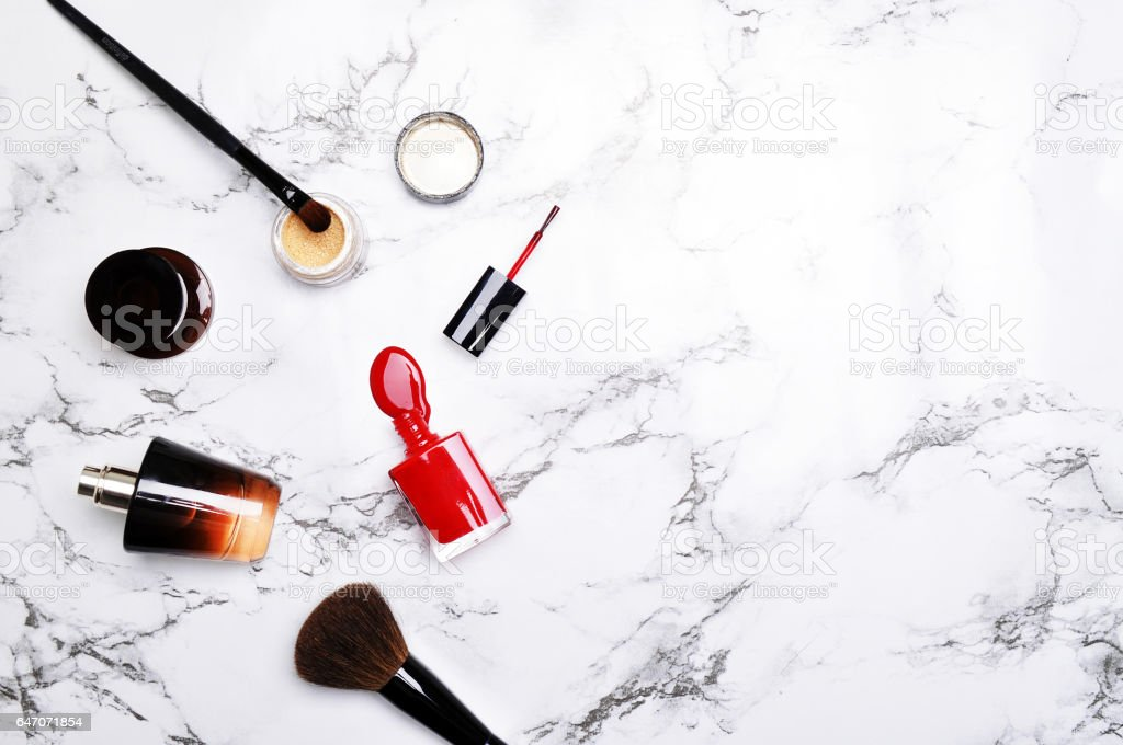 Flat lay. Accessories on the marble table. Mockup product . Woman desktop stock photo
