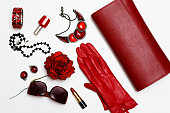 flat lay feminini red clothes and accessories collage on white