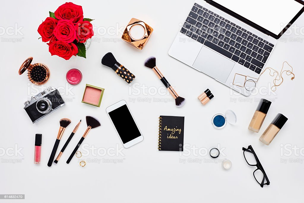 Flat lay of beauty products and technology on bloggers desk stock photo