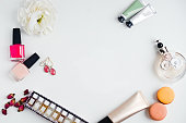 Flat lay of fashion beauty products on a white background