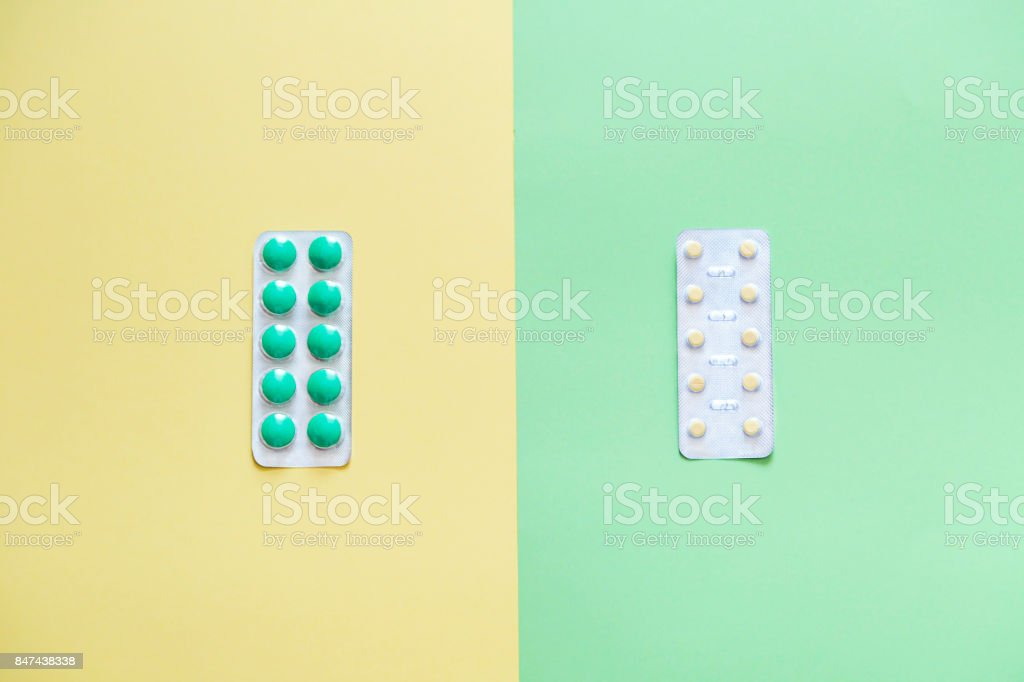 Flat lay of flu therapy. Opposition of traditional and science treatment. stock photo