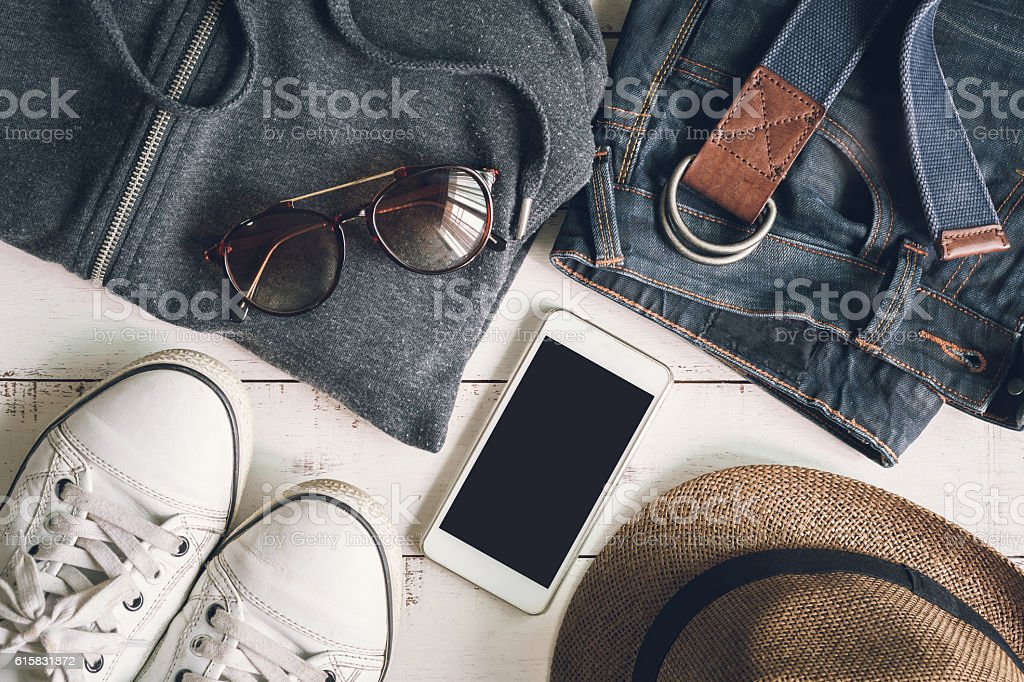 Flat lay of men casual fashion outfits on wooden background stock photo
