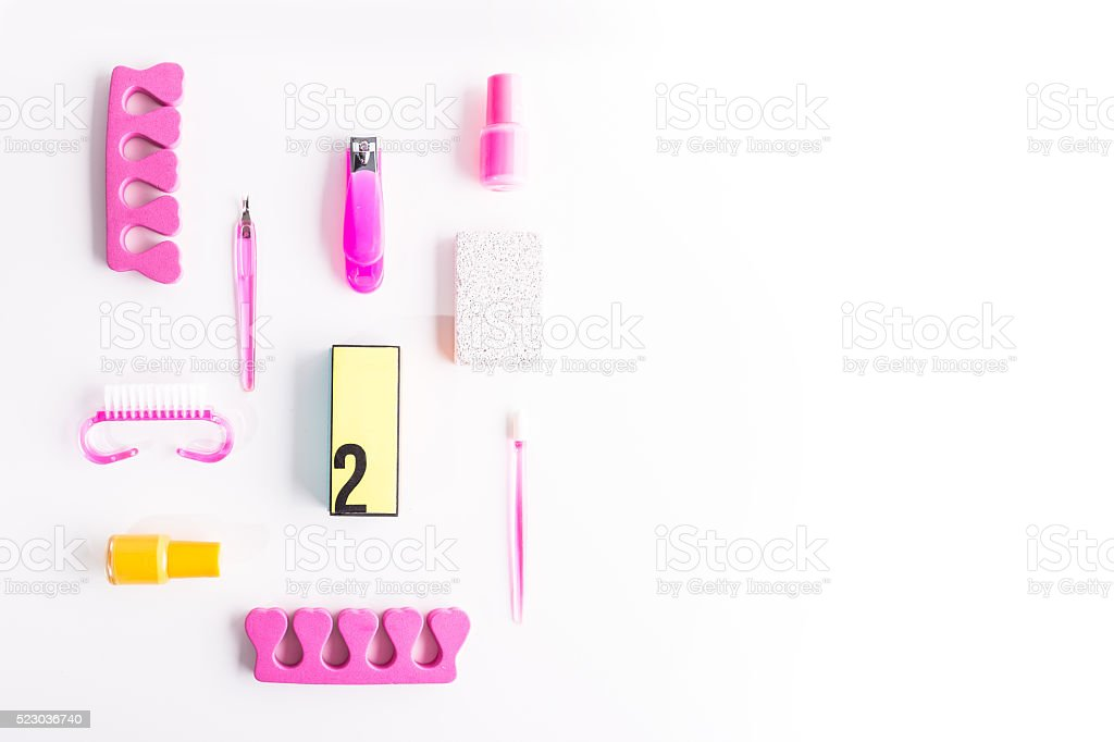 Flat lay of nail work concept. Pink and yellow colors stock photo