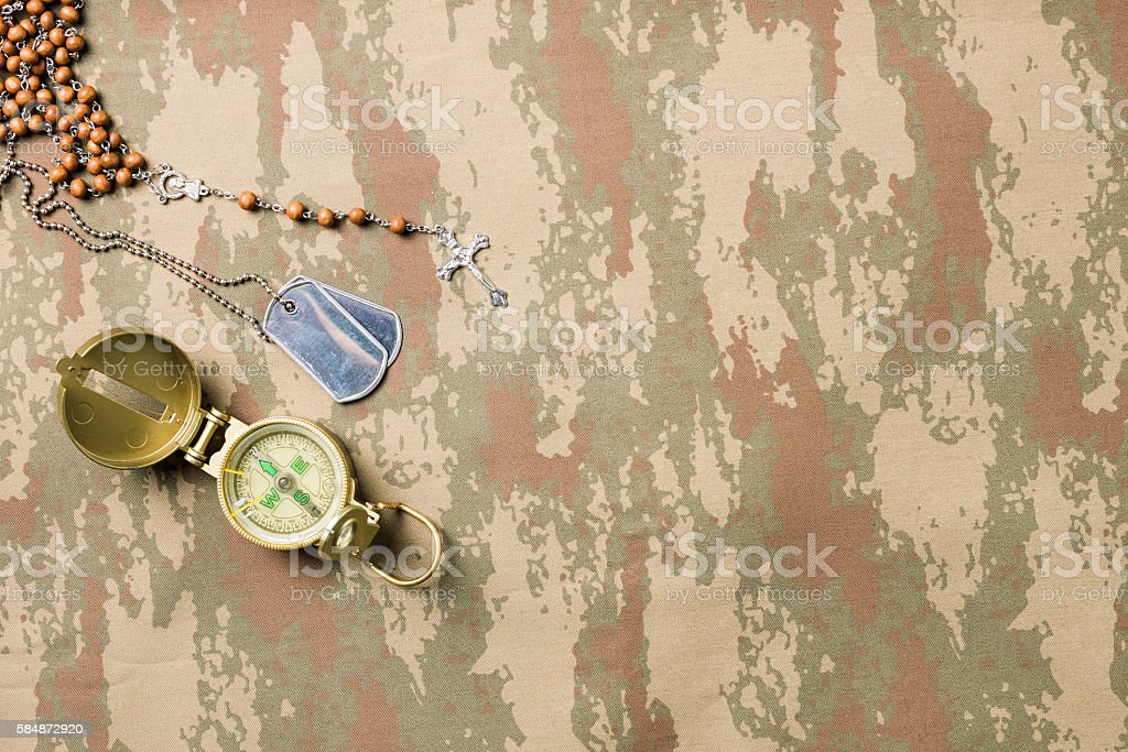 Flat lay Of Patriotism Symbols And Military On Camouflage Fabric stock photo