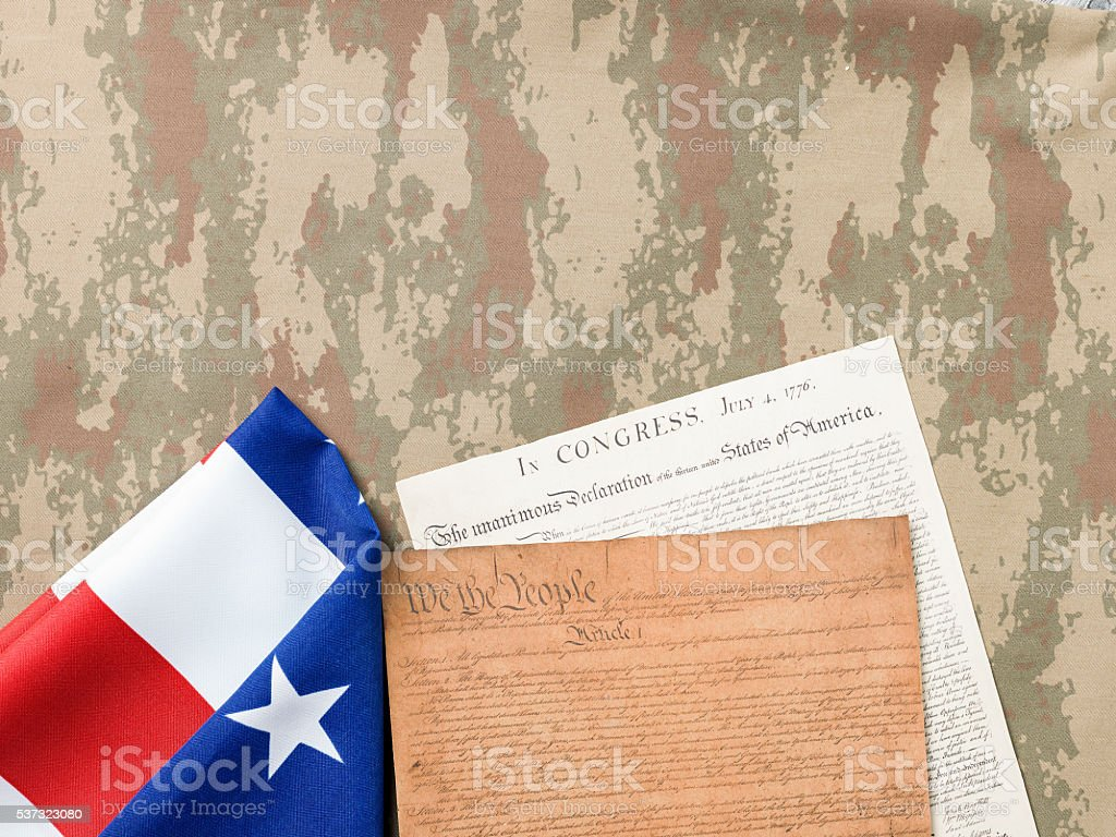 Flat lay Of Patriotism Symbols On Camouflage Fabric stock photo