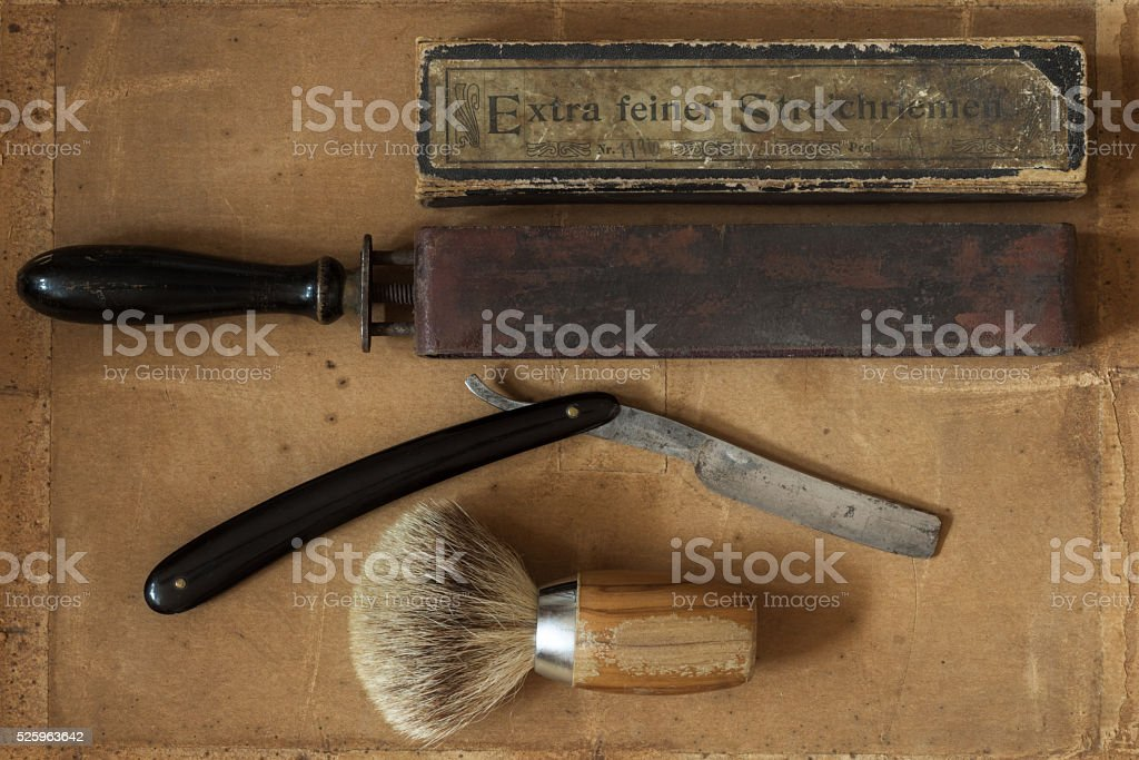 Flat Lay of Shaving Equipment on vintage Background stock photo