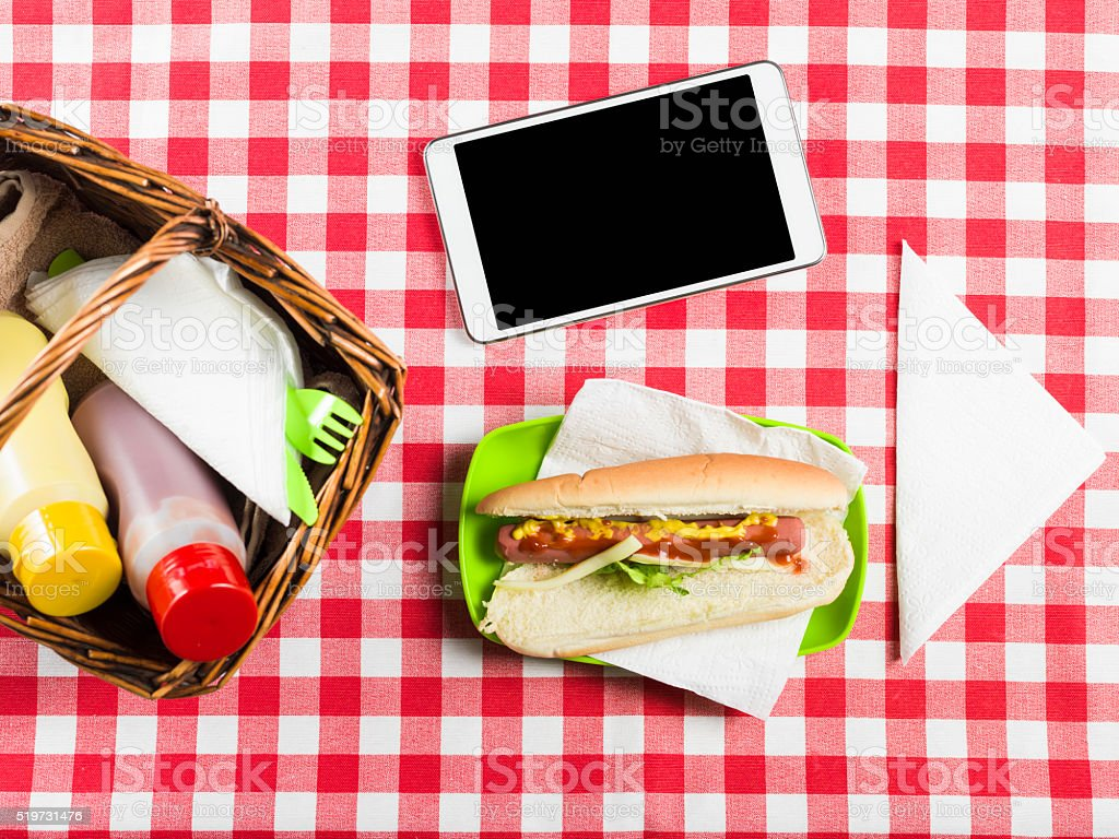 Flat Lay Of Table With Sandwich, Catchup,Mustard, Tablet Pc stock photo