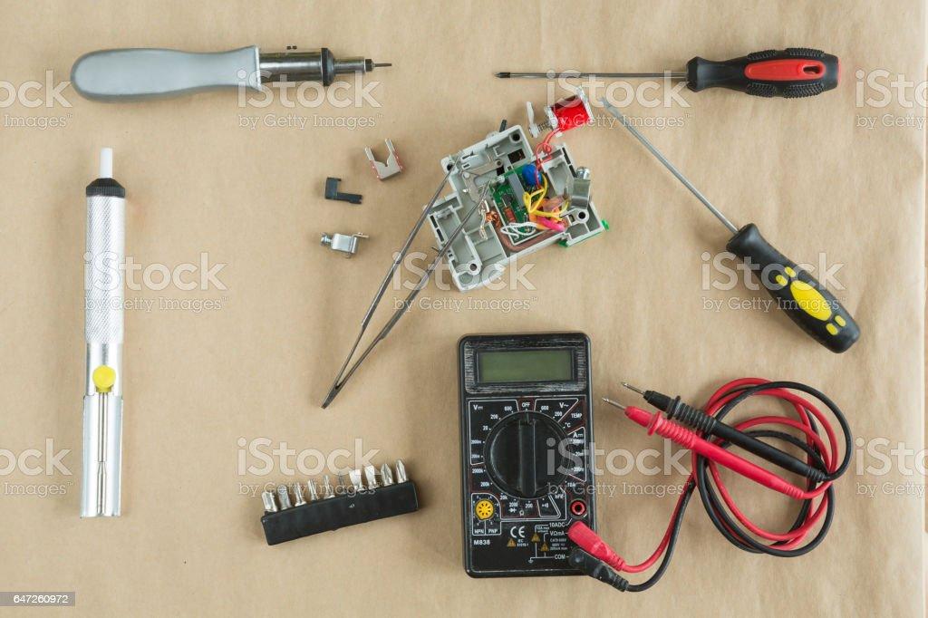 Flat lay of Tools for electrician Repair - multimeter , tweezers,...