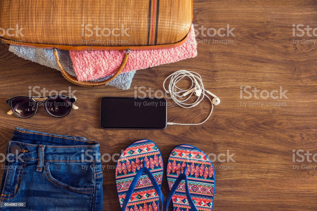 Flat lay of travel and beach accessories stock photo