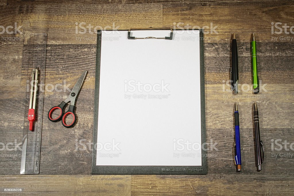 Flat lay - office, clamp board with pencils, scissors, ruler stock photo