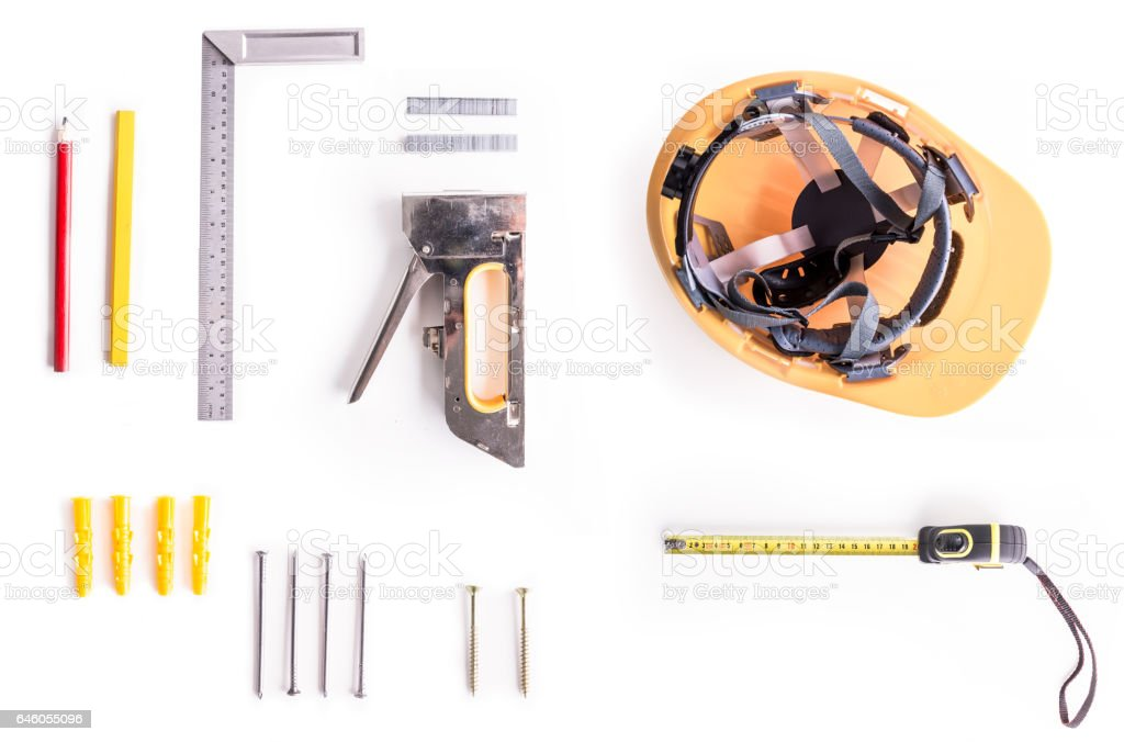 Flat lay shoot of carpentry tools on white background. stock photo