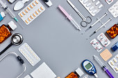 Flat lay shot of various medical equipment on gray background