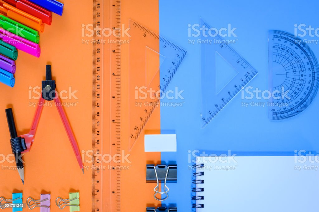 Flat lay, top view office table desk. feminine desk workspace with succulent, laptop, glasses, diary on orange and blue background. stock photo